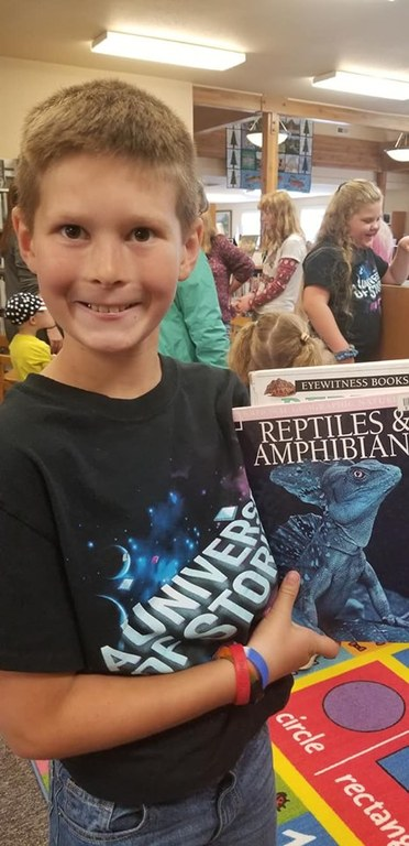 Excited about reading, about reptiles..