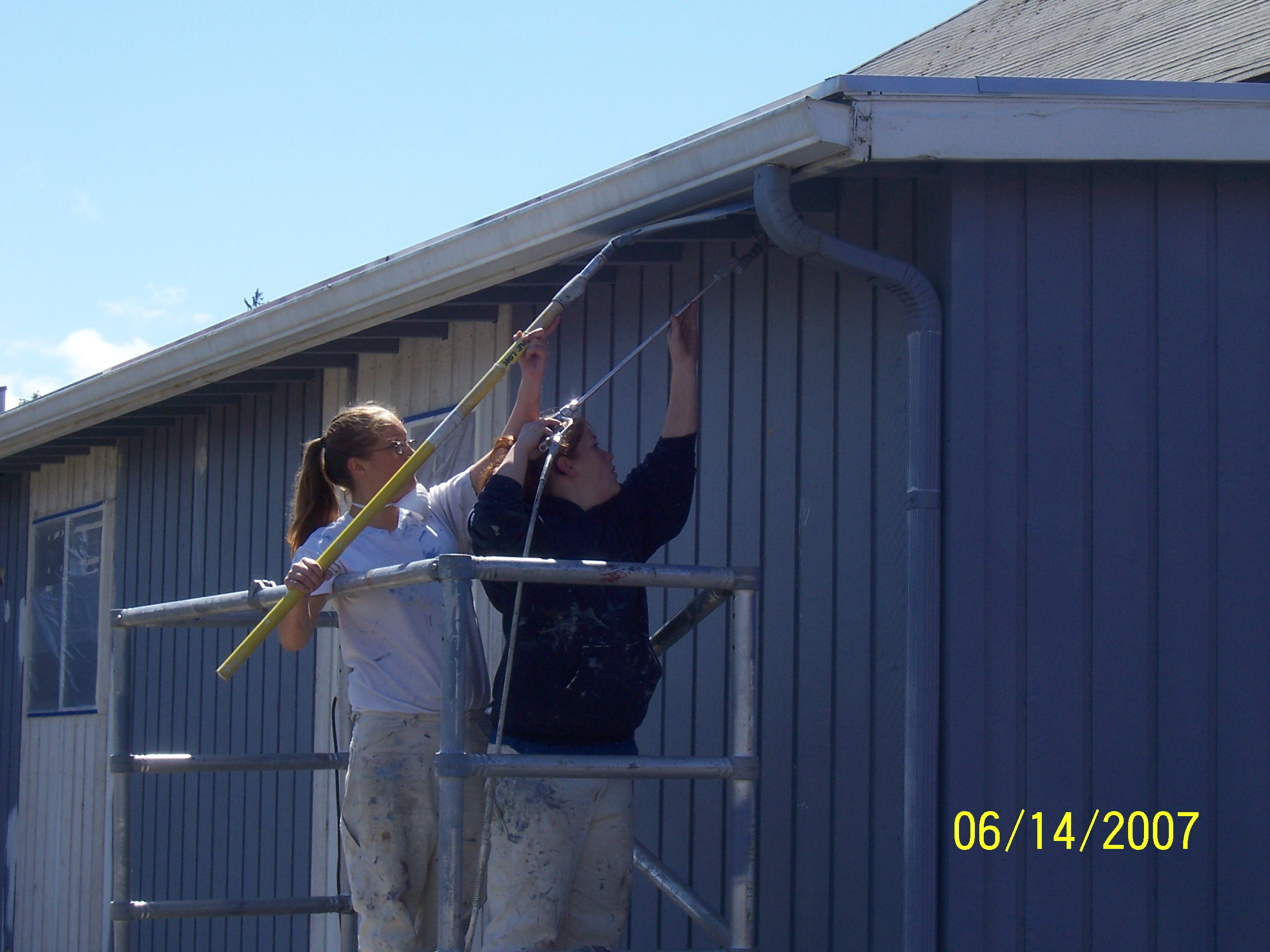 Job Corps. students painting side of library!