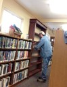 Darrel puts finishing touches on shelves