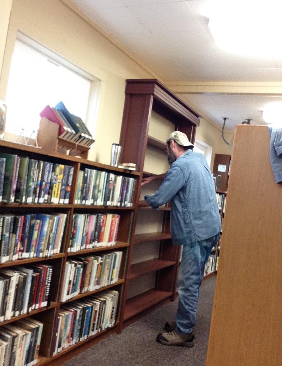 Darrel puts finishing touches on shelves